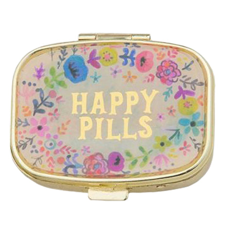 "This small pill box has a design of pink, purple, and blue flowers. In the middle, in yellow lettering, are the words, ""Happy Pills""."