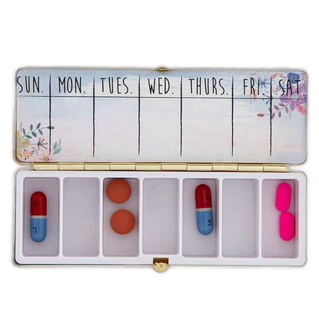 "The opened ""Decide to Be Happy"" Daily Pill Box has plenty of space for medications seven days a week."