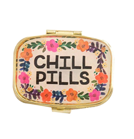 "Cream colored pillbox with words that read ""Chill Pills"" in black and a colorful floral design on a white background."
