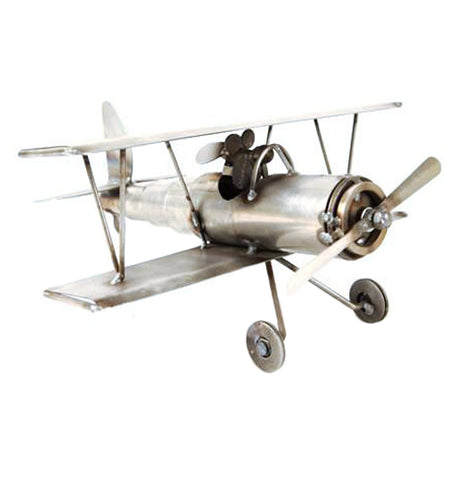 This handcrafted metal biplane sculpture has a dog as its pilot.