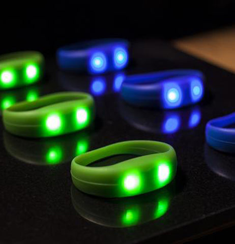 Two sets of blue and green glowing rings are shown.