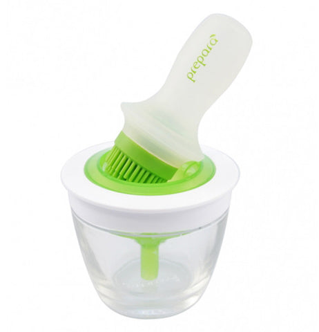 The dip & go bowl and basting brush comes with a clear plastic bowl with a green and white lid.  The basting brush has an opaque handle with green bristles at the tip.