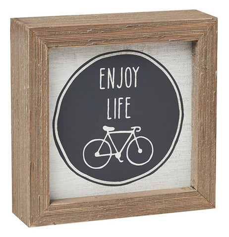 "The box sign has ""Injoy Life"" in black and white and a bike and a wooden boarder."