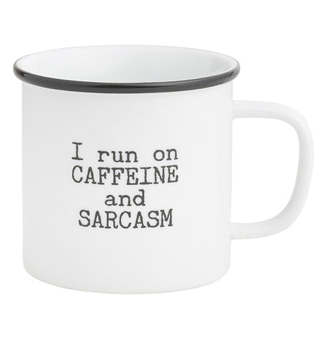 "This white mug with a black ring around its brim has the words, ""I Run on Caffeine and Sarcasm"" in black lettering."