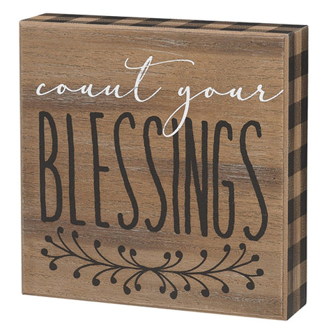 "The ""Count Your Blessings"" Box Sign features white and black words over a natural wood background that says, ""Count Your Blessings""."