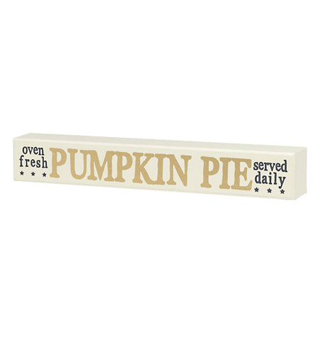 "A white wooden sign with the phrases ""Oven Fresh"" ""Pumpkin Pie"" and ""Served Daily"""