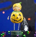 "The ""Punkin Pie"" figurine stands in front of a spooky tree with orange lights."