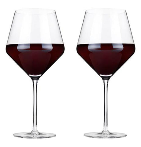 Two wine glasses with what appears to be wine in them.