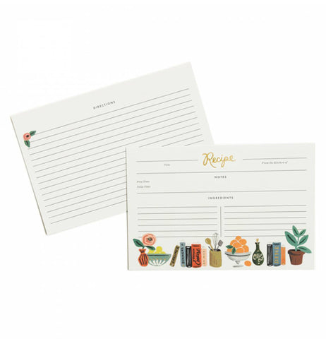 Both sides of the recipe cards with the plant, fruit bowl, and book designs shown on the front of the card. The back part is shown with a small flower at the top in a corner above the lines.