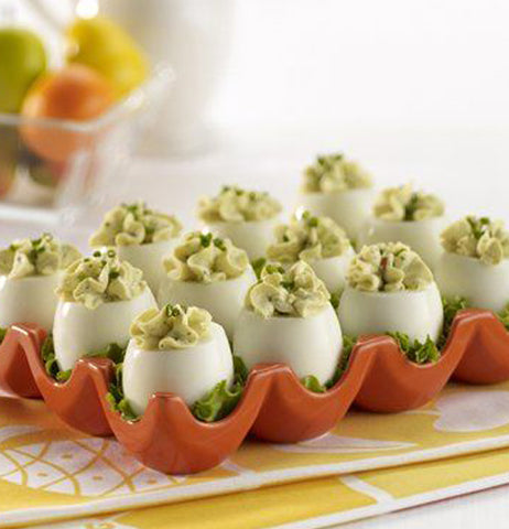 Deviled eggs are shown in the red egg tray.