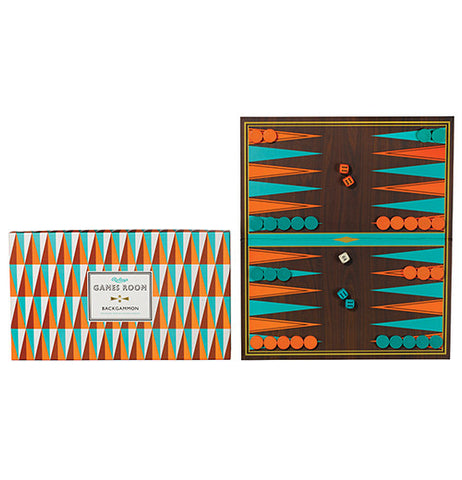 Backgammon Game in geometric colors orange, turquoise and brown placed next to its box.
