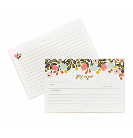 A recipe card with flowers on it