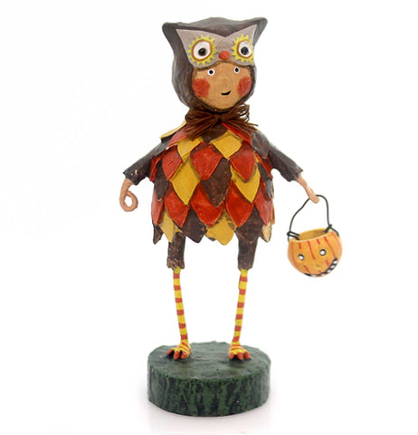 This figurine is of a boy dressed in an owl costume with brown, orange, and yellow while holding a trick or treat pumpkin bucket.
