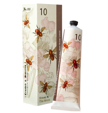 Shea butter lotion. The container and packaging is white with bees.