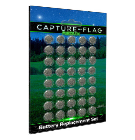 "This is a set of 40 small disc-shaped batteries. In their packaging is a cardboard piece with a picture of a field at night. The words at the top of the packaging say, ""Capture the Flag"" in white lettering."