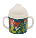Sippy cup has mermaids and sea life on it and is green with a white top.