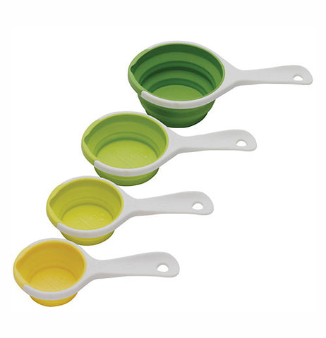 set of 4 pinch + pour collapsible measuring cups. Three are green and one is yellow