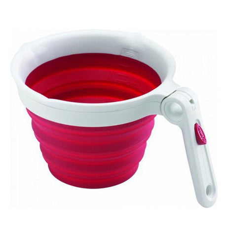 This 2-Cup measuring cup is red on the bottom and white on the top and handle
