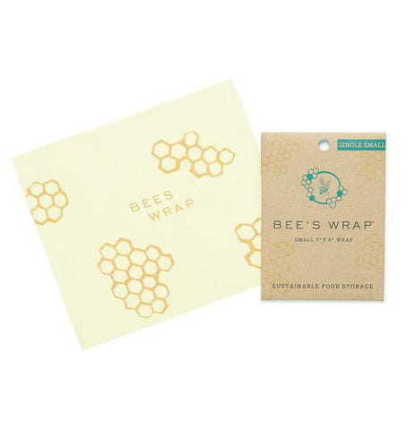 Reusable Wrap-Sandwich Bee's Wrap with its packaging beside it over a white background.