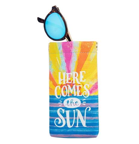 "This sunglass case has the design of a sun rising in the ocean with a message that says, ""Here Comes the Sun"" in white lettering with the sunglasses sticking out."