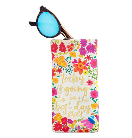 "This Sunglass Case has sunglasses sticking out. The case has a red, magenta, yellow, and orange floral design with a message that says, ""Today is Going to Be the Best Day Ever"" in gold lettering."