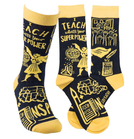 "A pair of yellow and black socks and a single sock say, ""I teach what's your superpower Inspire"" in yellow lettering."