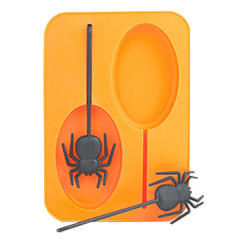Orange ice mold with black spider popsicle stick.
