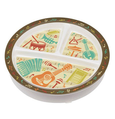 Baby plate with music instruments on it.