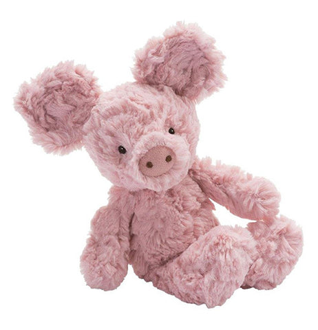 This stuffed toy is of a small pink pig with two black dots on the nose for nostrils, and two black pellets for eyes.