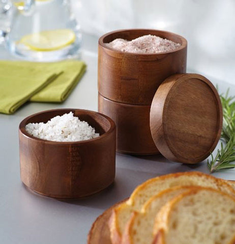 Set of 2 stacking salt round boxes showing seasonings inside the boxes.