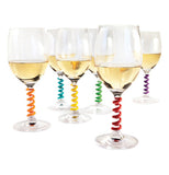Set of 6 wine stem spring charms all 6 are different colors they are on glasses of wine.