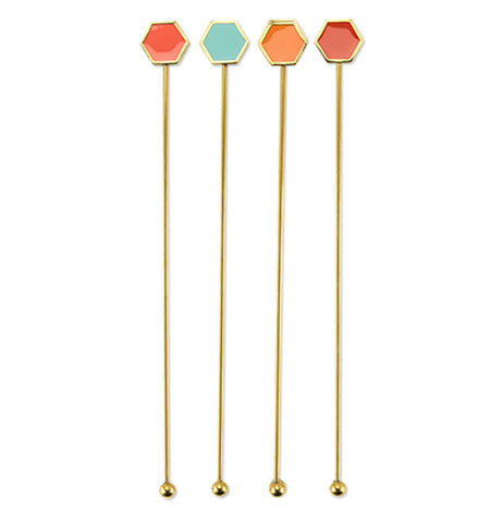 Gold toned stirring sticks with enameled geometric top fitting : coral, red, turquoise, and orange in package.