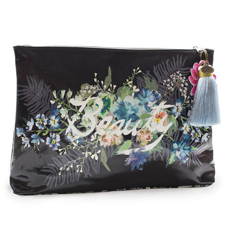 "This black bag has a pattern of white, blue, and green flowers with the word, ""Beauty"" in white lettering. A blue tassel hangs from the zipper."