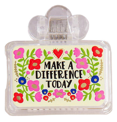 "This toothbrush cover has the words, ""Make a Difference Today"" in black lettering surrounded by red, pink, and blue flowers."