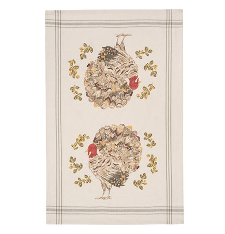 An off-white tea towel with two decorative turkeys