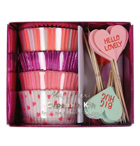 The pink, orange, and white cupcake holders are shown in their packaging with their heart signs.