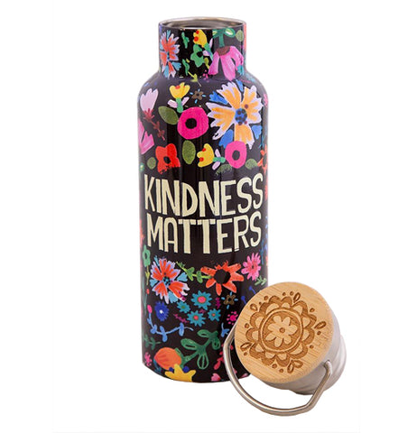 "This black water bottle has the words, ""Kindness Matters"" in cream colored lettering in the middle. Pink, orange, yellow, and red flowers surround the words."