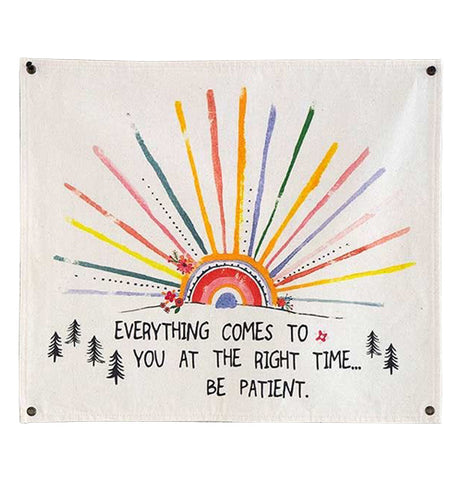 "The ""Be Patient"" Wall Hanging Art reads, ""Everything Comes to You At the Right Time Be Patient"" in black along with a multi-colored rising sun and tree design."