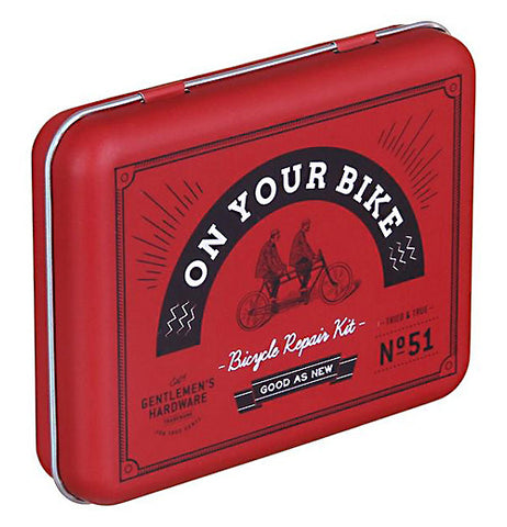 "Bicycle repair kit in a red box that says ""On Your Bike."""