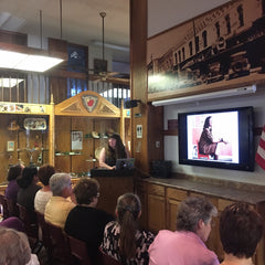 Mary Perisho presenting a modern quilting presentation at the Northwest Arkansas Modern Quilt Guild meeting