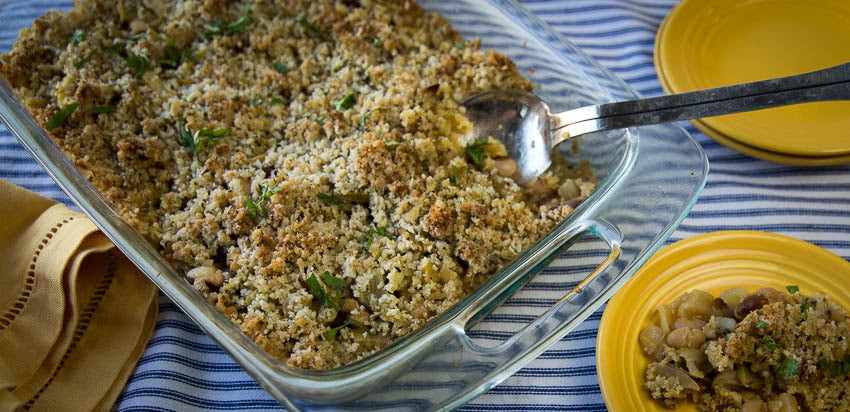 Baked casserole with yellow eye beans, fennel, and breadcrumbs.
