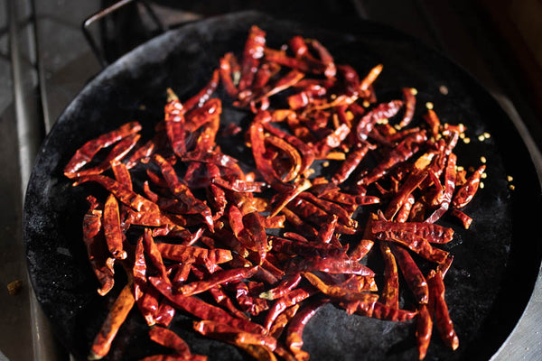 Dried Chile De Arbol toasting on a comal, Rancho Gordo