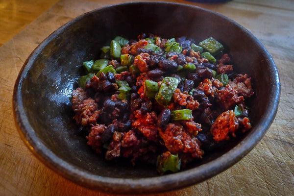 Cooked Midnight beans mixed with chorizo, and nopales - Rancho Gordo, Heirloom beans