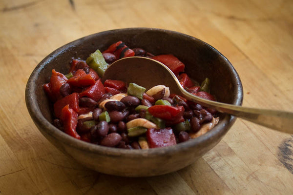 Bowl of cooked Domingo Rojo beans mixed with peppers and nopales, Rancho Gordo-Heirloom beans