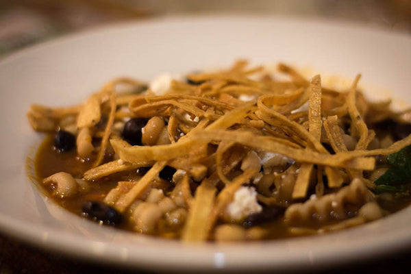 Ayocote Negro soup topped with fried tortilla strips-Rancho Gordo, Heirloom beans.