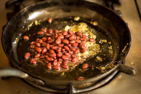 Domingo Rojo beans fried on a skillet with diced onions, Rancho Gordo-Heirloom beans