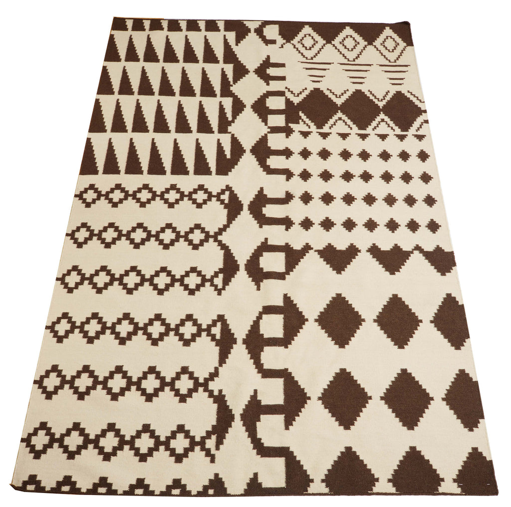 Bark Rug 5x8 feet. The rug is hand woven by artisans in India in New Zealand wool.