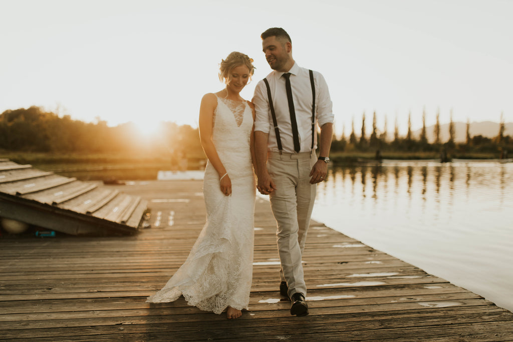 Truvelle Boho wedding dress vancouver and bridal boutique offering plunging V-neck lace bridal gowns.