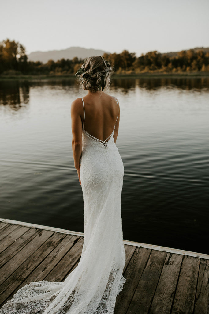 Bridal Shops New Westminster creating custom wedding dresses with V-neck and low back.