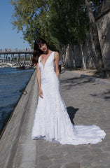 Vancouver Wedding Dress worn by bride in Paris while standing along the river.